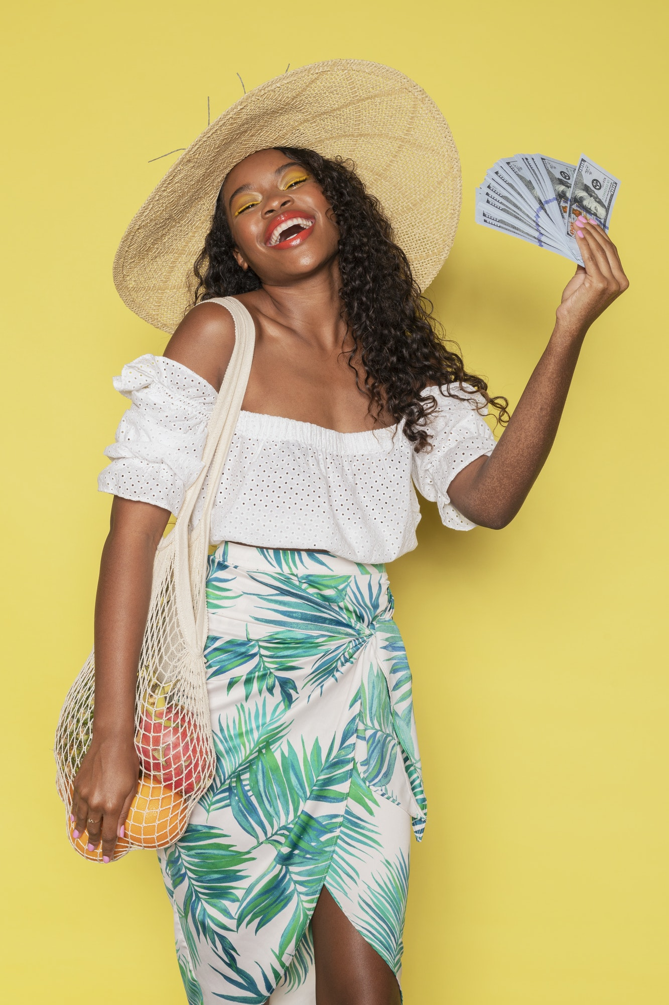 Happy woman spending money during her summer vacation